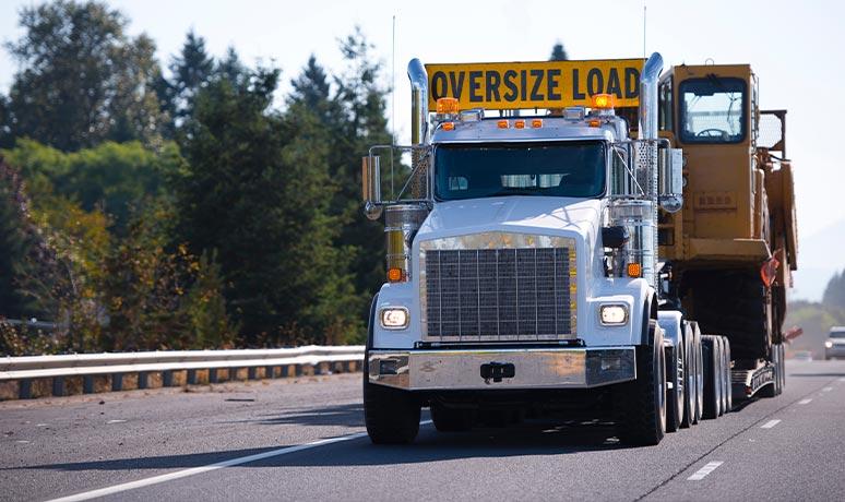 heavy construction equipment transportation in fresno
